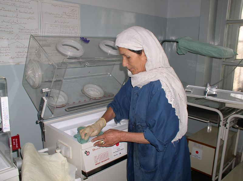 The dear cleaning lady in the nursery. she has perfected the art of keeping the nursery spotless. here she is taking apart/cleaning one of the incubators.