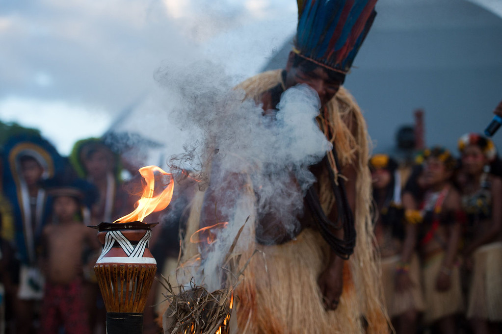 . Brazilian natives attend the sacred fire ceremony, on the eve of the official opening ceremony of the first International Games of Indigenous Peoples in Cuiaba, state of Mato Grosso, on November, 8, 2013. 48 Brazilian ethnic groups and indigenous representatives from 16 countries are taking part in the event which runs until November 16.   AFP PHOTO / CHRISTOPHE SIMON