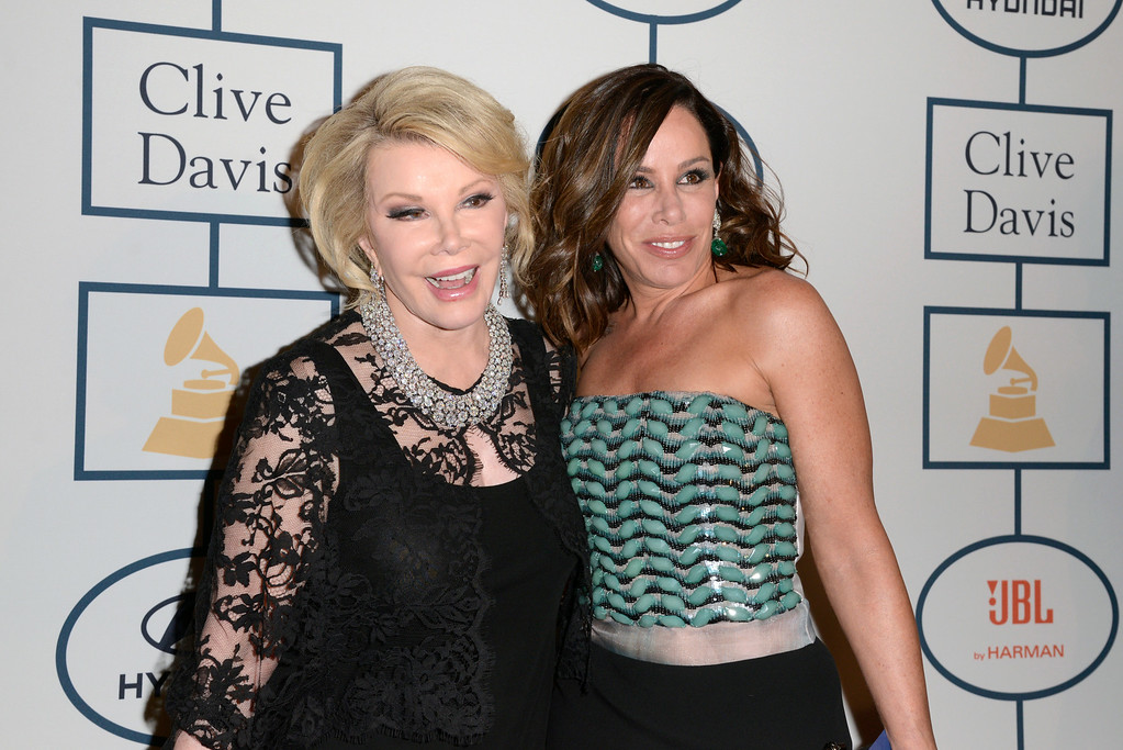 . Joan Rivers, left, and Melissa Rivers arrive at the 56th annual GRAMMY awards - salute to industry icons with Clive Davis, on Saturday, Jan. 25, 2014, in Beverly Hills, Calif. (Photo by Dan Steinberg/Invision/AP)