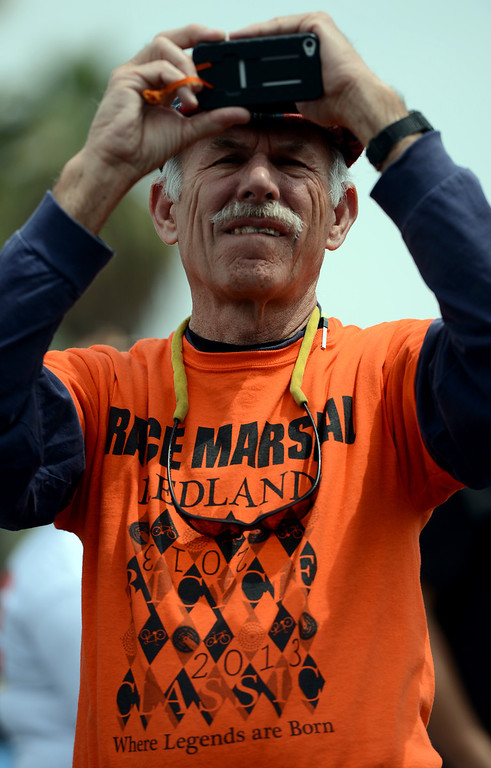 . Steve Higbee, 66, of Banning and a Race Marshall for the Redlands Bicycle Classic takes a photo at the end of the Sunset Road Race for Women Sunday April 7, 2013. Crowds of spectators gather along the streets of Redlands for the final day of the 29th Annual Redlands Bicycle Classic. Rick Sforza/Staff photographer