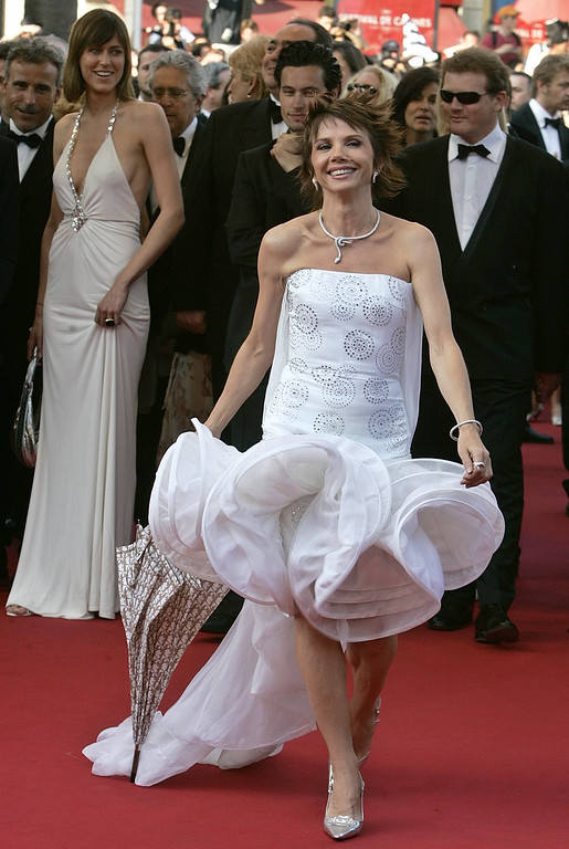 ". Spanish actress Victoria Abril, smiles as she arrives for screening of her film""Cache\""(Hidden), directed by Michael Haneke, shown in competition at the 58th international Cannes film festival in Cannes, southern France, Saturday May 14, 2005. (AP Photo/Michel Euler)"