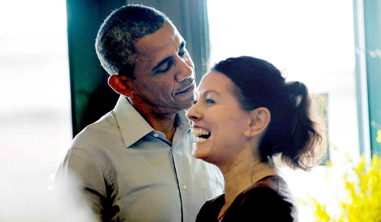 . President Barack Obama jokes with Lisa McCannin of St. Paul at the Golden Fig in St. Paul on Thursday. Lisa\'s sister Lauri Crowell owns the store. (Pioneer Press: Ben Garvin)