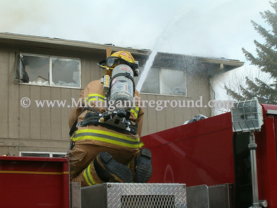 2/24/05 - Lansing Twp building fire, 300 Western, bldg H