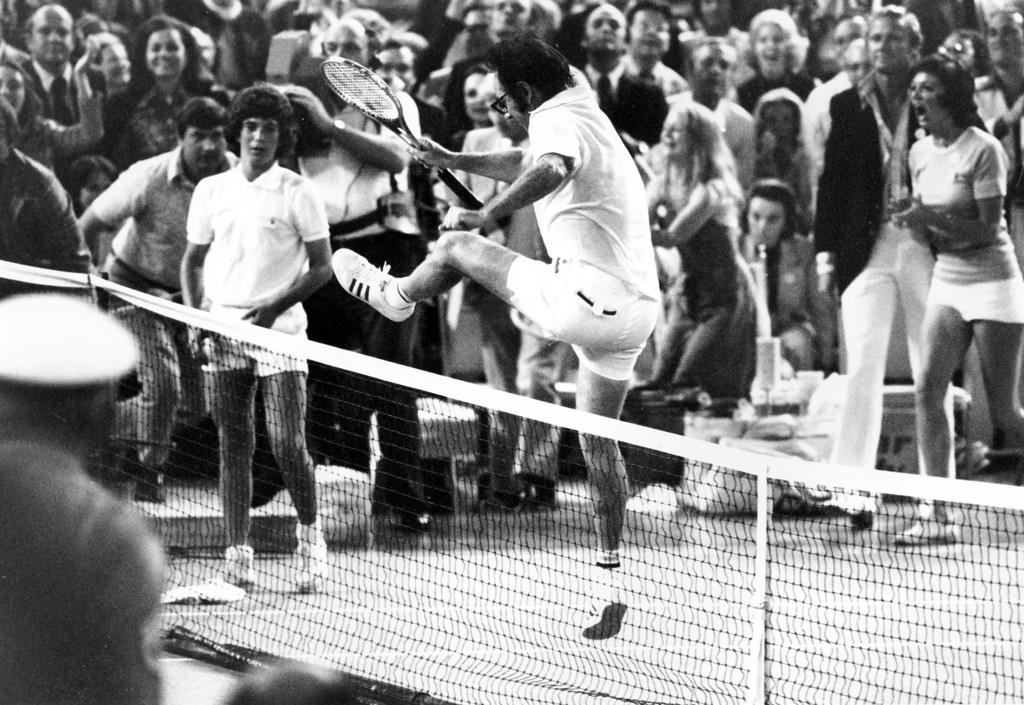 . Bobby Riggs leaps over the net to congratulate Billie Jean King after she beat him in straight sets in the Houston Astrodome, Texas, on Sept. 20, 1973.  King won 6-4, 6-3, 6-3.  (AP Photo)