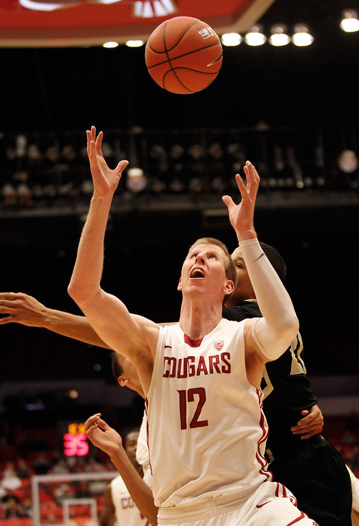 . PULLMAN, WA - JANUARY 19:  Forward Brock Motum #12 of the Washington State Cougars goes up for a rebound during the second half of the game against the Colorado Buffaloes at Beasley Coliseum on January 19, 2013 in Pullman, Washington.  (Photo by William Mancebo/Getty Images)
