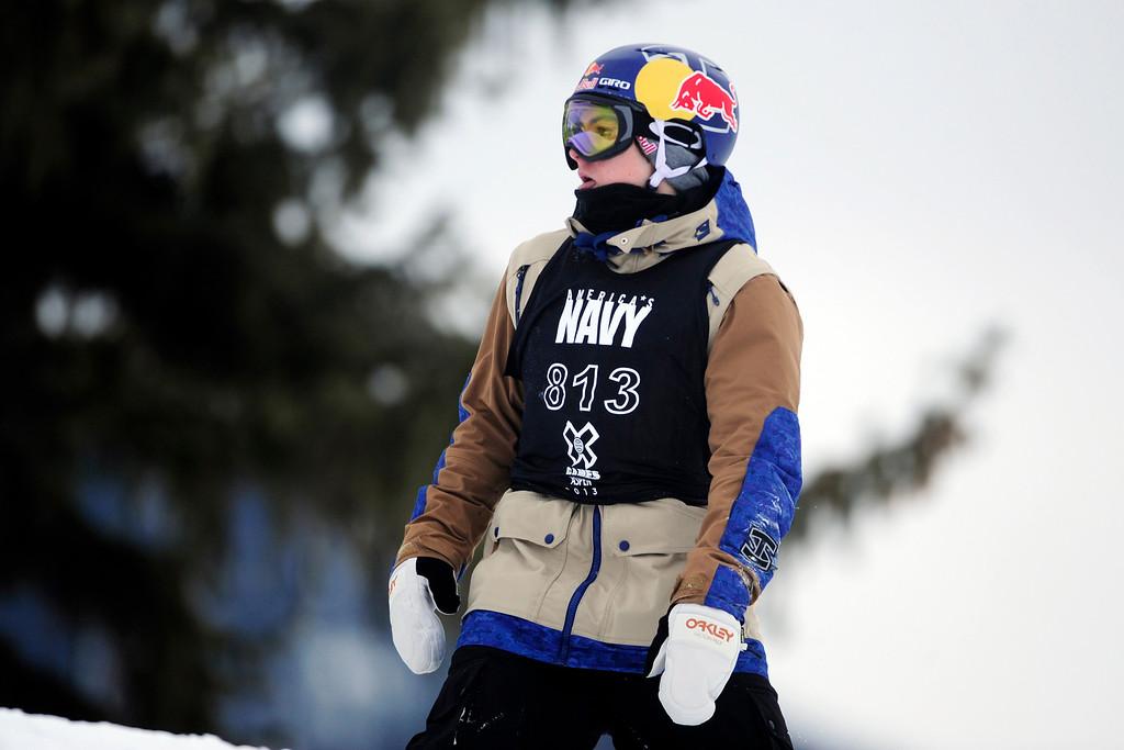 . ASPEN, CO. - JANUARY 24: Sebastian Toutant reacts to falling during the men\'s Snowboard Slopestyle elimination. Men\'s Snowboard Slopestyle elimination X Games Aspen Buttermilk Mountain Aspen January 24, 2013. (Photo By AAron Ontiveroz / The Denver Post)