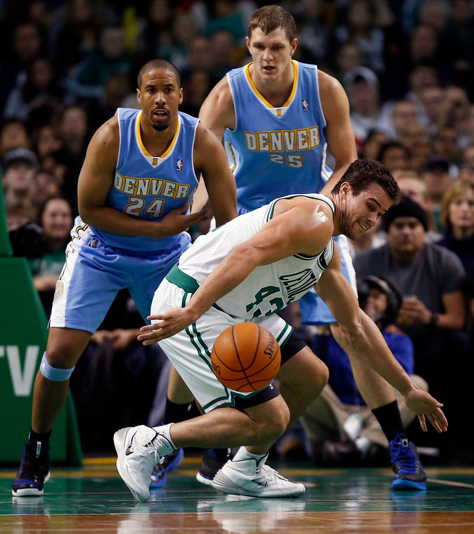 . Boston Celtics\' Kris Humphries (43) loses control of the ball in front of Denver Nuggets\' Andre Miller (24) and Timofey Mozgov (25) in the second quarter of an NBA basketball game in Boston, Friday, Dec. 6, 2013. (AP Photo/Michael Dwyer)