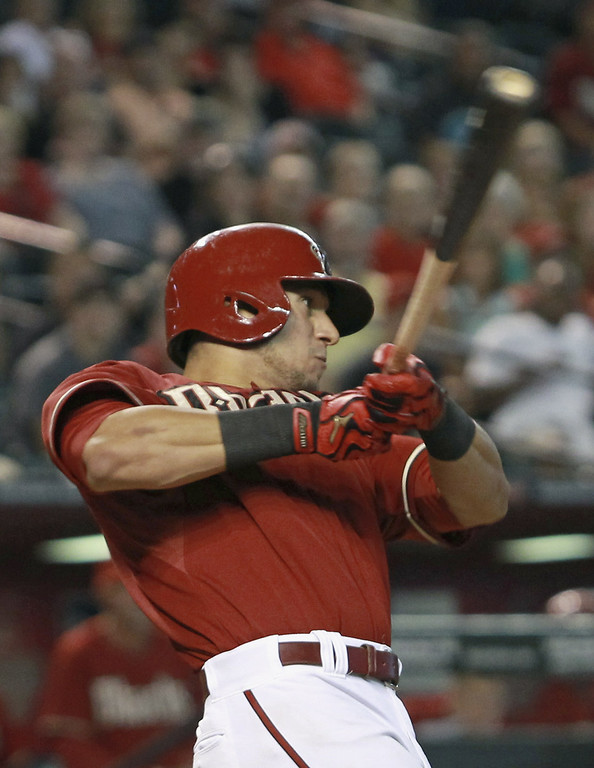 . David Peralta #6 of the Arizona Diamondbacks swings at a pitch against the Colorado Rockies during the eighth inning of a MLB game at Chase Field on August 31, 2014 in Phoenix, Arizona.  (Photo by Ralph Freso/Getty Images)