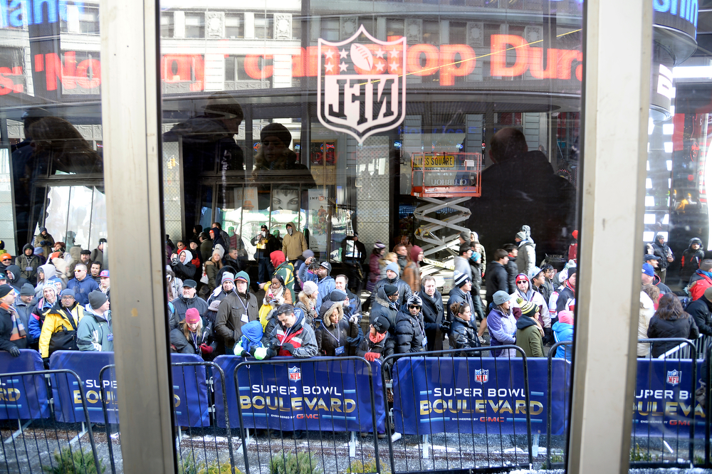 . Super Bowl XLVlll fans hit Times Square to enjoy the Super Bowl Boulevard. The NFL transformed a portion of Broadway into the sports and entertainment hub of Super Bowl Week, January 29, 2014. (Photo by John Leyba/The Denver Post)
