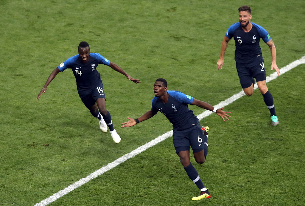 . France\'s Paul Pogba, center, celebrates after scoring his side\'s third goal during the final match between France and Croatia at the 2018 soccer World Cup in the Luzhniki Stadium in Moscow, Russia, Sunday, July 15, 2018. (AP Photo/Thanassis Stavrakis)