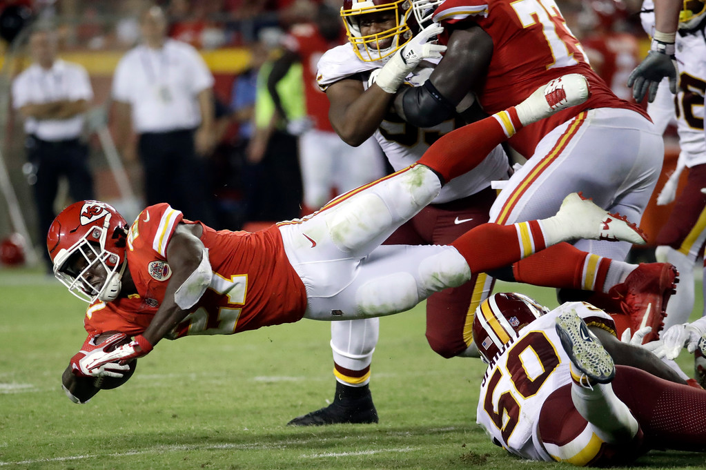 . Kansas City Chiefs running back Kareem Hunt (27) dives for extra yardage during the second half of an NFL football game against the Washington Redskins in Kansas City, Mo., Monday, Oct. 2, 2017. (AP Photo/Charlie Riedel)