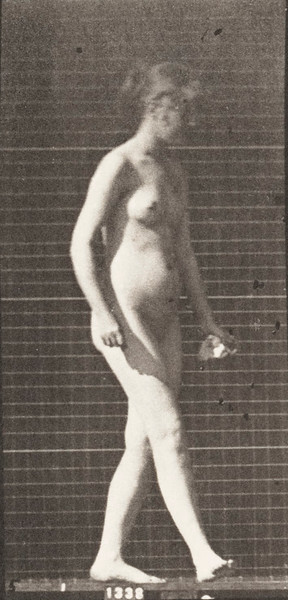 Nude woman walking and turning around