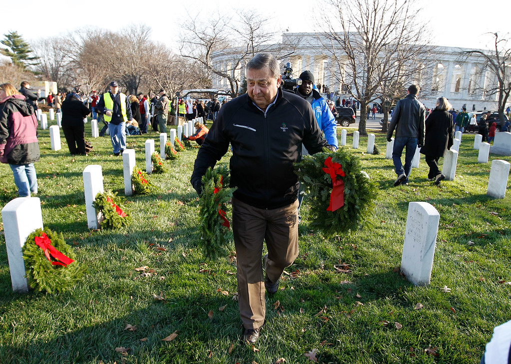 . Gov. Paul LePage of Maine volunteers to lays a holiday wreaths at the graves of fallen soldiers at Arlington National Cemetery in Washington Saturday Dec. 10, 2011, during Wreaths Across America Day.  (AP Photo/Jose Luis Magana)
