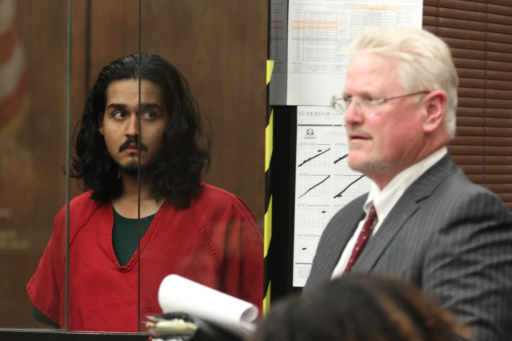 . Mark Estrada, 21, left, appears in court along with his attorney Richard Pointer, for an arraignment hearing at the Hayward Hall of Justice in Hayward, Calif., on Friday, July 24, 2015. Estrada is accused of fatally shooting Hayward Police Sgt. Scott Lunger. (Anda Chu/Bay Area News Group)