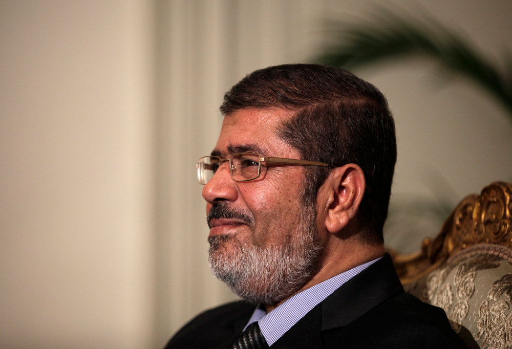 ". Egyptian President Mohammed Morsi poses during a photo opportunity at the presidential palace in Cairo, Egypt, Saturday, Dec. 8, 2012. Egypt\'s military said Saturday that serious dialogue is the ""best and only\"" way to overcome the nation\'s deepening conflict over a disputed draft constitution hurriedly adopted by Islamist allies of President Mohammed Morsi, and recent decrees granting himself near-absolute powers. (AP Photo/Maya Alleruzzo)"