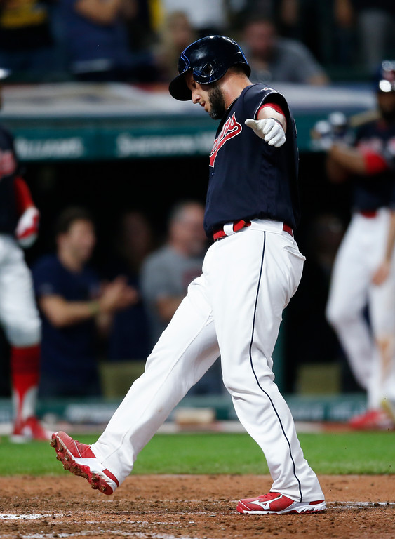 . Cleveland Indians\' Yan Gomes steps on home plate after hitting a solo home run off Minnesota Twins relief pitcher Michael Tonkin during the sixth inning in a baseball game, Wednesday, Sept. 27, 2017, in Cleveland. (AP Photo/Ron Schwane)