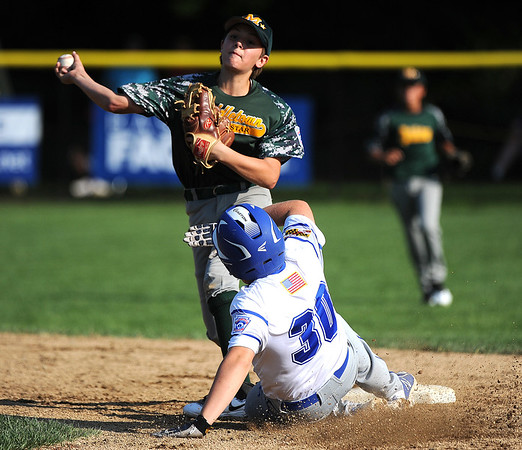 8/6/2018 Mike Orazzi | Staff Middletown New Jersey Little League's Leland Ossner (2) gets a force out on Maryland's Case Tilghman (30) at Breen Field in Bristol during the 2018 Little League Eastern Regional Tournament.