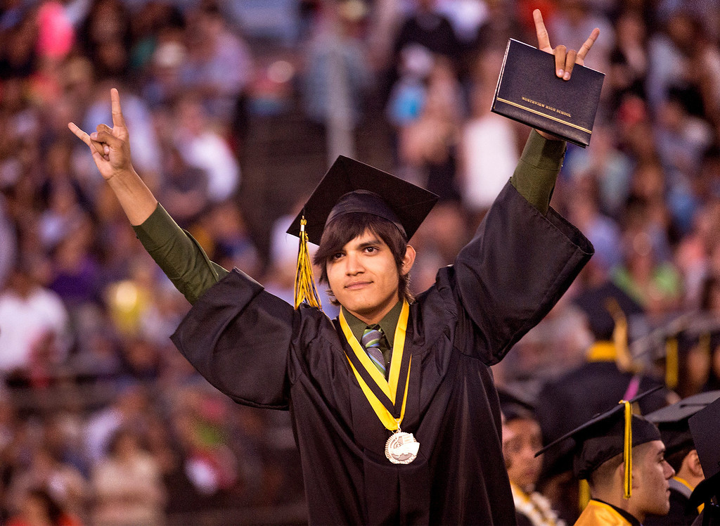 . Michael Lopez jubilates during the Northview High commencement ceremony at Covina District Field June 11, 2014.   (Staff photo by Leo Jarzomb/San Gabriel Valley Tribune)