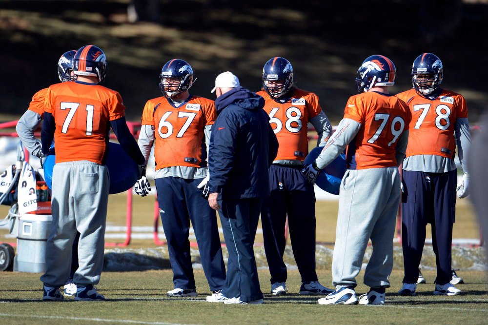 . Denver Broncos offensive lines gets in some reps during  practice Wednesday, January 9, 2013 at Dove Valley.  John Leyba, The Denver Post