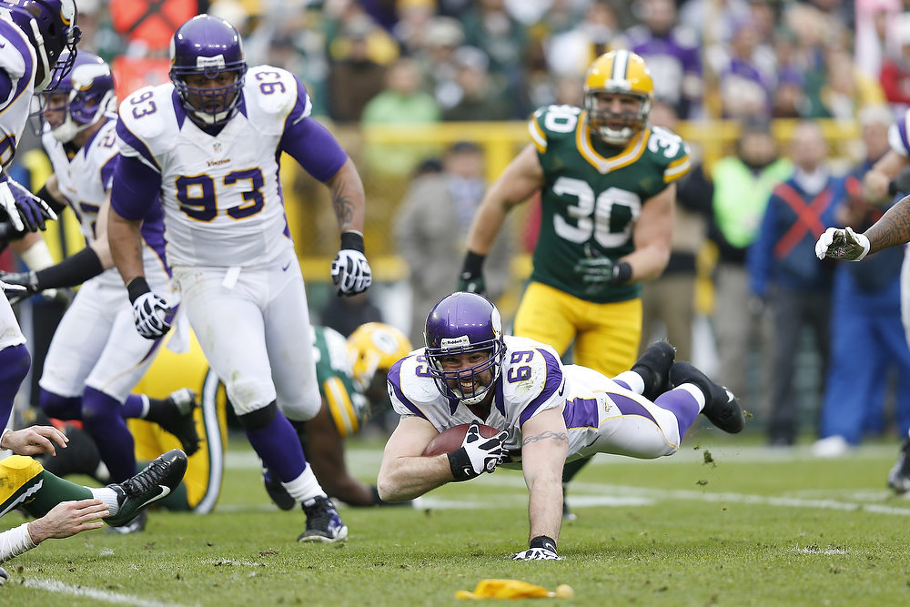 . Jared Allen #69 of the Minnesota Vikings intercepts a pass that was negated by a penalty against the Green Bay Packers during the game at Lambeau Field on December 2, 2012 in Green Bay, Wisconsin. The Packers won 23-14. (Photo by Joe Robbins/Getty Images)