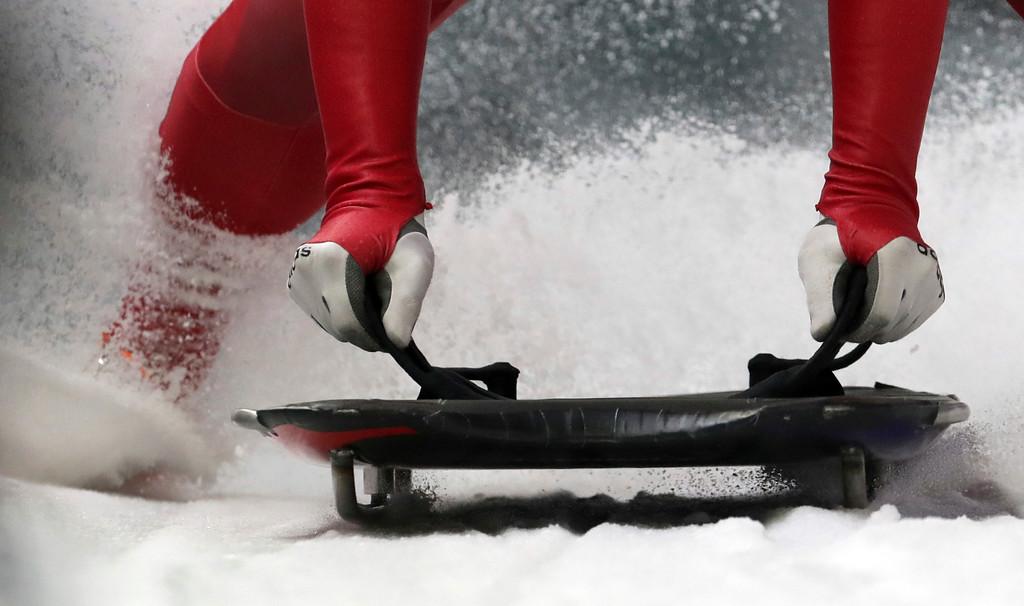 . Jisoo Kim of South Korea brakes in the finish area during the men\'s skeleton training at the 2018 Winter Olympics in Pyeongchang, South Korea, Wednesday, Feb. 14, 2018. (AP Photo/Michael Sohn)