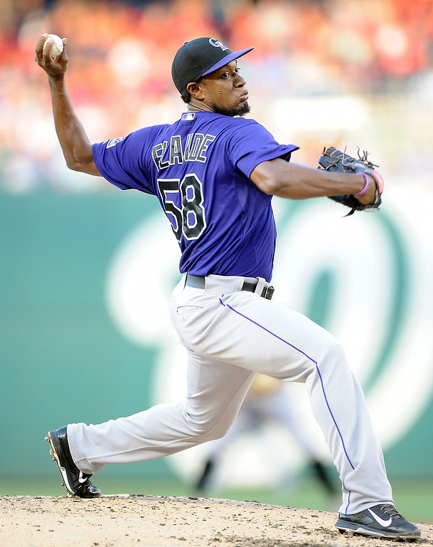 . WASHINGTON, DC - JUNE 30: Yohan Flande #58 of the Colorado Rockies pitches in the second inning against the Washington Nationals at Nationals Park on June 30, 2014 in Washington, DC.  (Photo by Greg Fiume/Getty Images)