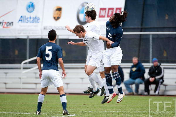 Nov 13, 2011; Ann Arbor, MI, USA; Northwestern Wildcats midfielder Chris Ritter (6) heads the ball over Penn State Nittany Lions forward Jordan Tyler (23) in the first half at the final game of the 2011 Big Ten Championship at Michigan Soccer Stadium. Mandatory Credit: Tim Fuller-US PRESSWIRE