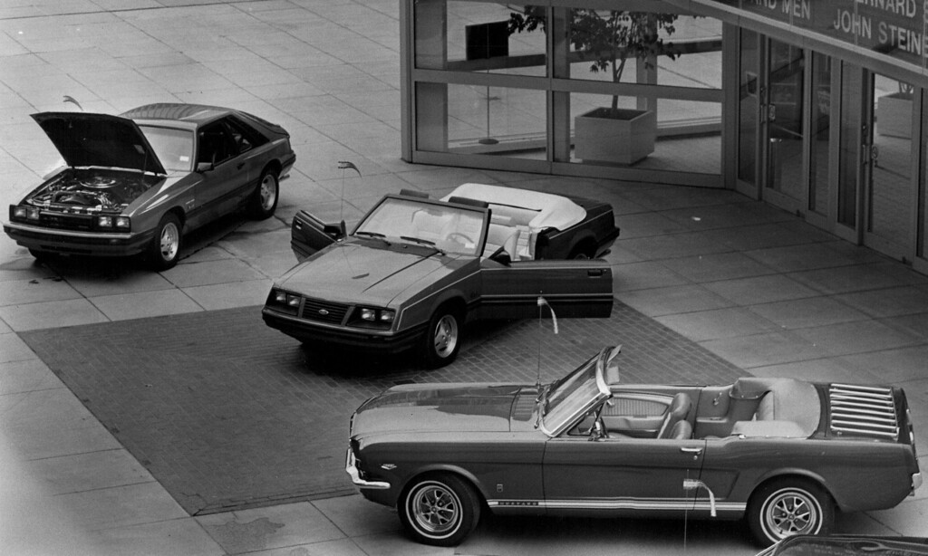 . Among Fords on display in Denver 19 1982 were, from left, the Capri RS, 1983 Mustang GLX and a 1965 Mustang convertible. Credit: The Denver Post