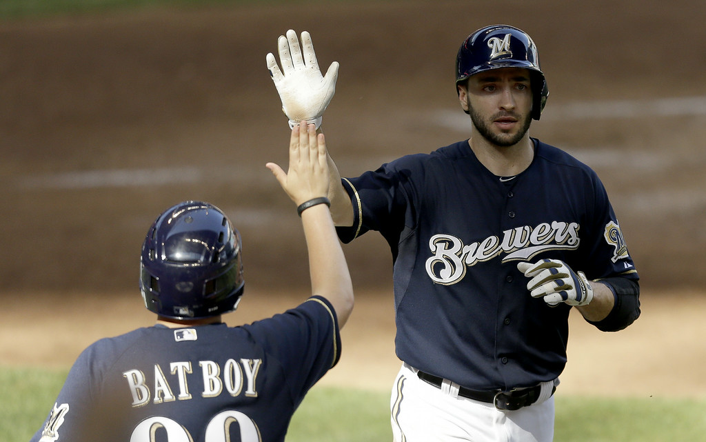 . MILWAUKEE, WI - JUNE 28: Ryan Braun #8 of the Milwaukee Brewers celebrates after reaching home plate on a fielders choice hit by Jonathan Lucroy in the bottom of the fifth inning against the Colorado Rockies at Miller Park on June 28, 2014 in Milwaukee, Wisconsin. (Photo by Mike McGinnis/Getty Images)
