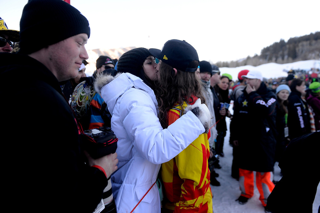 . ASPEN, CO - JANUARY 25: Colten Moore kisses his girlfriend Ashley Hammons as he celebrates his late brother, Caleb, who was killed in the snowmobile freestyle event at the 2013 X Games Aspen. X Games Aspen at Buttermilk on Friday, January 25, 2014. (Photo by AAron Ontiveroz/The Denver Post)