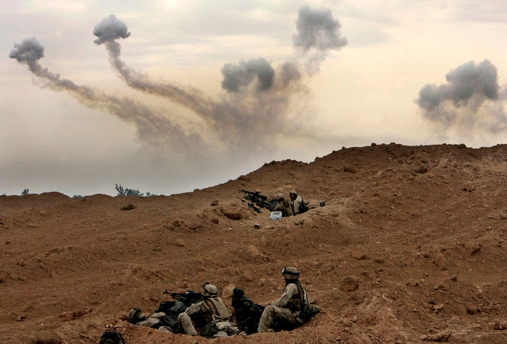 . U.S. Marines of the 1st Division take position on the outskirts of Fallujah, Iraq, Monday, Nov. 8, 2004. (AP Photo/Anja Niedringhaus)