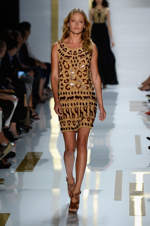 . Model Karmen Pedaru walks the runway at the Diane Von Furstenberg fashion show during Mercedes-Benz Fashion Week Spring 2014 at The Theatre at Lincoln Center on September 8, 2013 in New York City.  (Photo by Frazer Harrison/Getty Images for Mercedes-Benz Fashion Week Spring 2014)