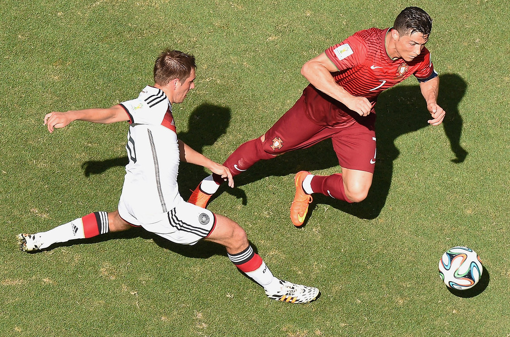 . Germany\'s defender and captain Philipp Lahm (L) tackles Portugal\'s forward and captain Cristiano Ronaldo during the Group G football match between Germany and Portugal at the Fonte Nova Arena in Salvador on June 16, 2014, during the 2014 FIFA World Cup.      AFP PHOTO / /POOL FRANCOIS XAVIER MARIT/AFP/Getty Images