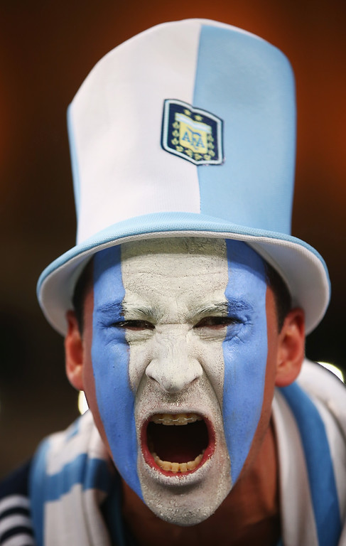 . An Argentina fan cheers prior to the 2014 FIFA World Cup Brazil Group F match between Argentina and Bosnia-Herzegovina at Maracana on June 15, 2014 in Rio de Janeiro, Brazil.  (Photo by Julian Finney/Getty Images)