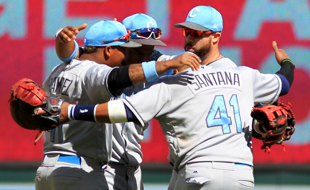 . Cleveland Indians Carlos Santana (41), Jose Ramirez (11), Bradley Zimmer (4) and Lonnie Chisenhall celebrate after defeating the Minnesota Twins, 5-2, during a baseball game on Sunday, June 18, 2017 in Minneapolis. (AP Photo/Andy Clayton-King)