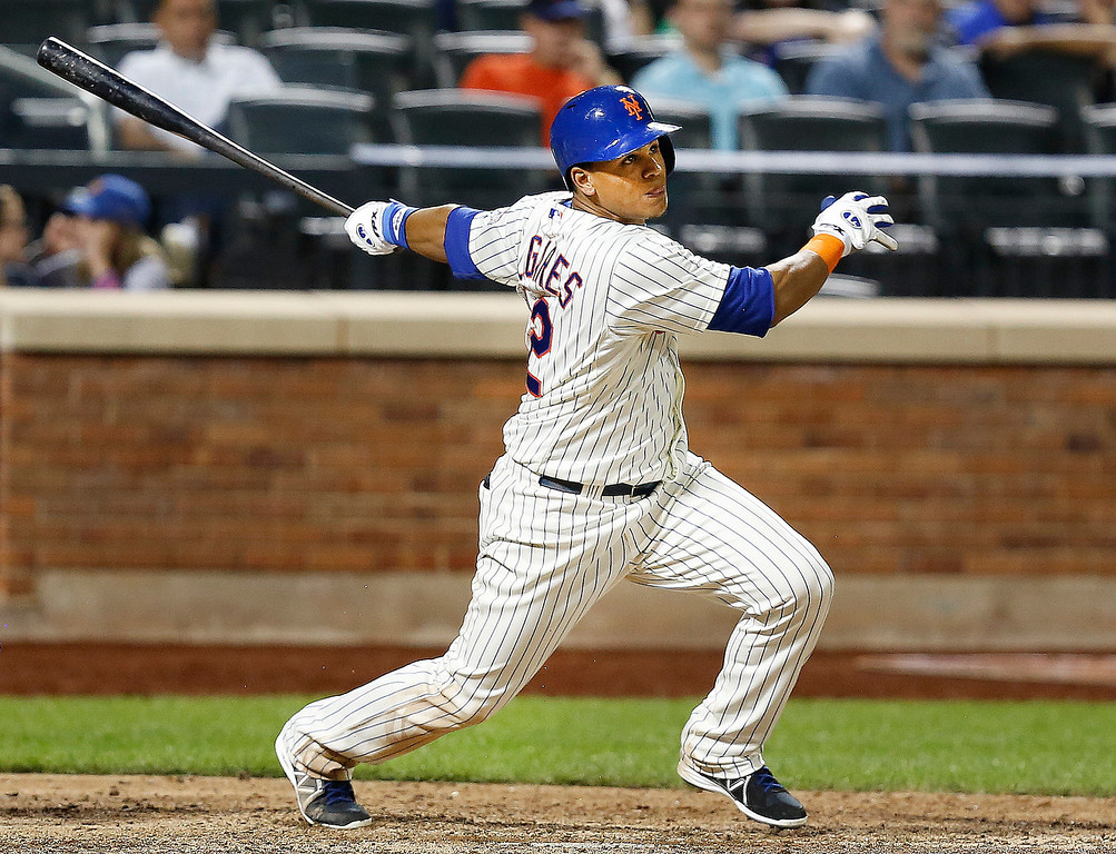 . New York Mets\' Juan Lagares hits an infield single to drive in a run in the eighth inning of a baseball game against the Colorado Rockies at Citi Field, Tuesday, Aug. 6, 2013, in New York. The Mets defeated the Rockies, 3-2. (AP Photo/John Minchillo)