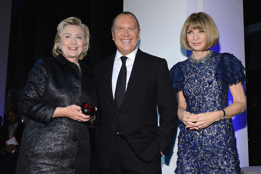 . NEW YORK, NY - OCTOBER 16:  (L-R) Hillary Rodham Clinton, recipient of the Michael Kors Award for Outstanding Community Service, Designer Michael Kors, and Vogue editor-in-chief Anna Wintour pose on stage at the God\'s Love We Deliver 2013 Golden Heart Awards Celebration at Spring Studios on October 16, 2013 in New York City.  (Photo by Larry Busacca/Getty Images for Michael Kors)