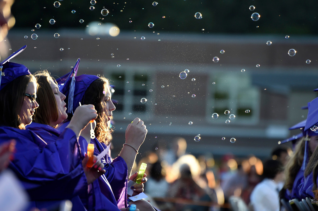 . Kayla Rice/Reformer Bubbles fill the air during the BUHS graduation ceremony on Friday evening.