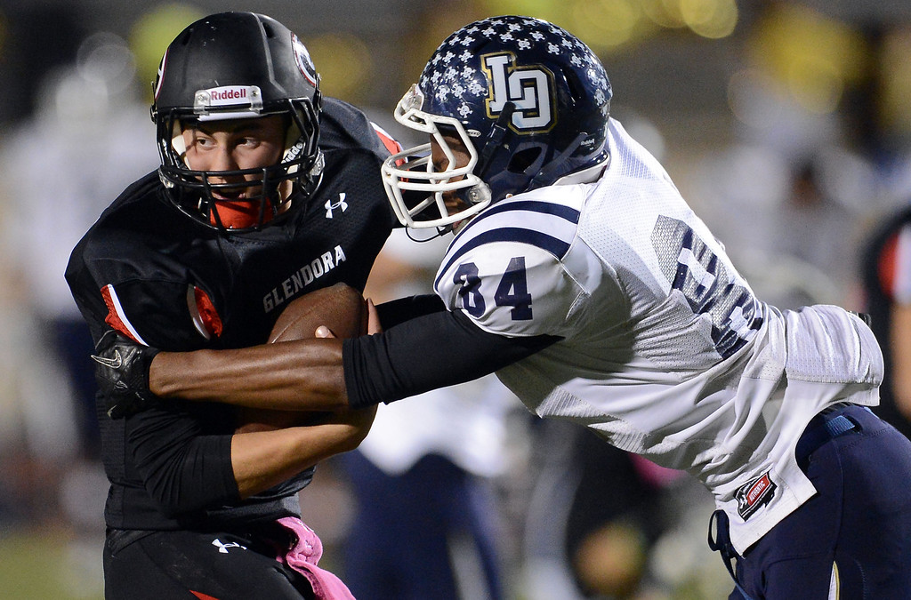 . Los Osos\' Michael West (84) sacks Glendora quarterback Matt Fink (12) in the first half of a prep football game at Citrus College in Glendora, Calif., on Thursday, Oct. 31, 2013.    (Keith Birmingham Pasadena Star-News)