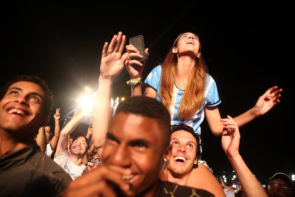 . Argentina fans celebrate at the FIFA Fan Fest on Copacabanaa Beach on June 15, 2014 in Rio de Janeiro, Brazil. The match was played on the fourth day of the World Cup tournament.  (Photo by Mario Tama/Getty Images)