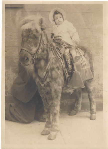 Baby Lucy rides horse .png