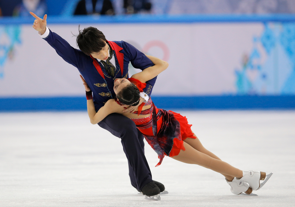 . Pang Qing and Tong Jian of China compete in the pairs free skate figure skating competition at the Iceberg Skating Palace during the 2014 Winter Olympics, Wednesday, Feb. 12, 2014, in Sochi, Russia. (AP Photo/Vadim Ghirda)