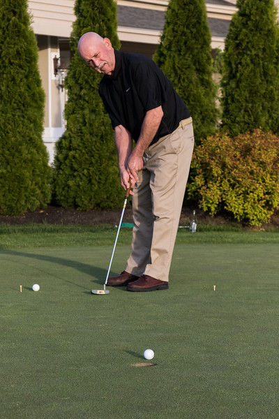 Jim Lamontagne wins the the putting contest during the Homeless Center for Strafford County's Spring Fling Fund Raiser Friday night in Somersworth. [Scott Patterson/Fosters.com]