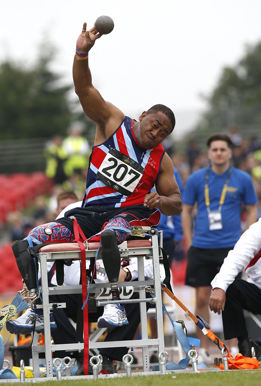 . Great Britain\'s Derek Derenalagi competes in the men\'s shot put IF-4 during the Invictus Games at Queen Elizabeth II Park in London on September 11, 2014. AFP PHOTO/ADRIAN DENNISADRIAN DENNIS/AFP/Getty Images