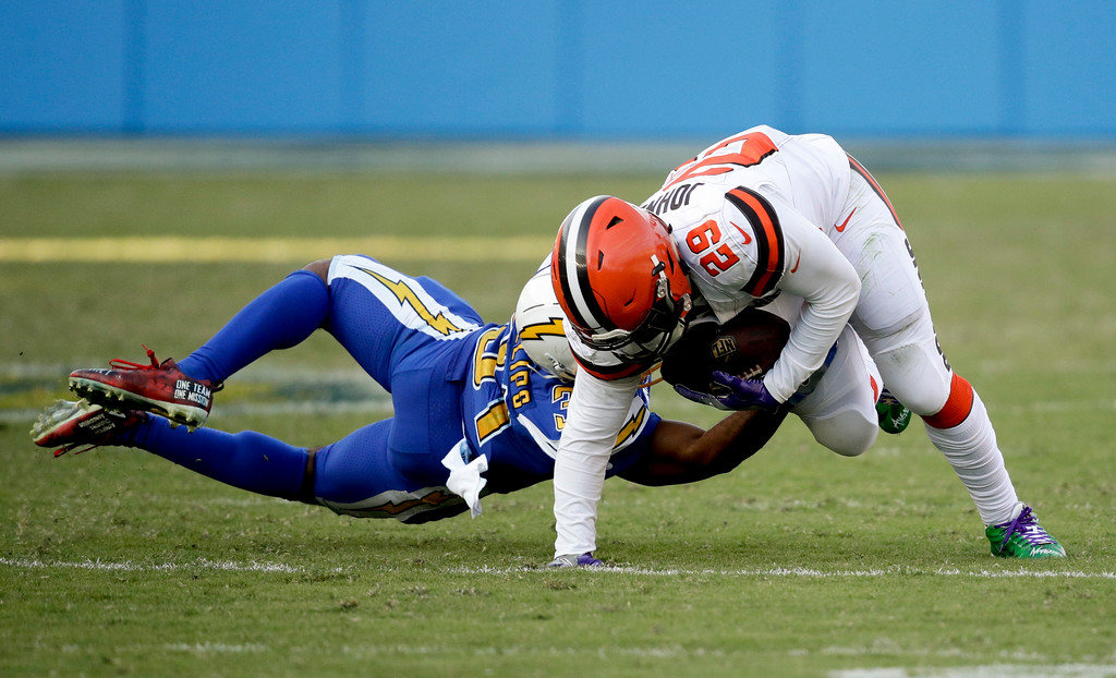 . Cleveland Browns running back Duke Johnson, right,breaks away from Los Angeles Chargers free safety Adrian Phillips during the second half of an NFL football game Sunday, Dec. 3, 2017, in Carson, Calif. (AP Photo/Jae C. Hong)
