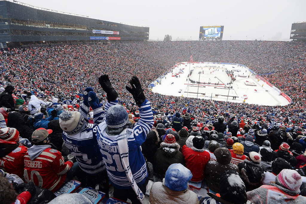 . Toronto Maple Leafs fans cheer after their team scored a goal in the third period against the Detroit Red Wings during the 2014 Bridgestone NHL Winter Classic on January 1, 2014 at Michigan Stadium in Ann Arbor, Michigan.  (Photo by Jamie Sabau/Getty Images)