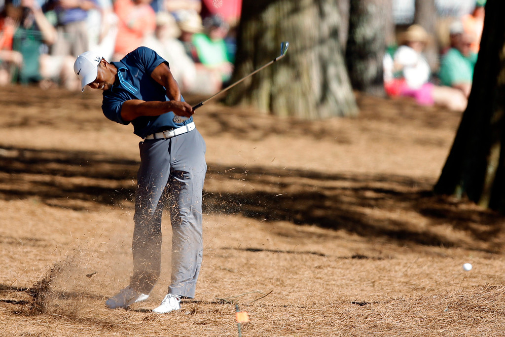 . Tiger Woods hits out of the rough off the 15th fairway during the third round of the Masters golf tournament Saturday, April 13, 2013, in Augusta, Ga. (AP Photo/Matt Slocum)