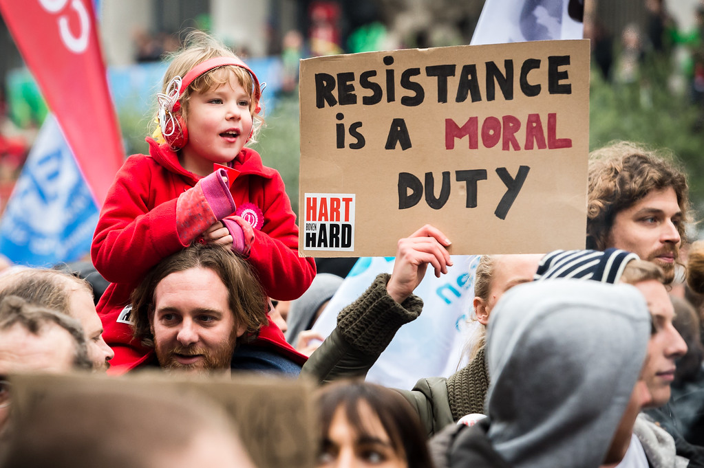 . A child sits on the shoulders of her father during a national trade union demonstration in Brussels, Thursday Nov. 6, 2014.  (AP Photo/Geert Vanden Wijngaert)