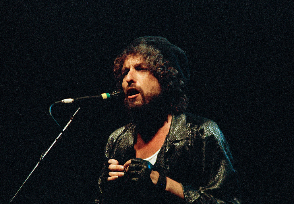 . Singer-songwriter Bob Dylan gives his first concert in Israel after his 20-year career in music, Sept. 6, 1987, in Tel Aviv. As many as 40,000 fans jammed the fairgrounds to hear him and Tom Petty and the Heartbreakers. (AP Photo/Anat Givon)