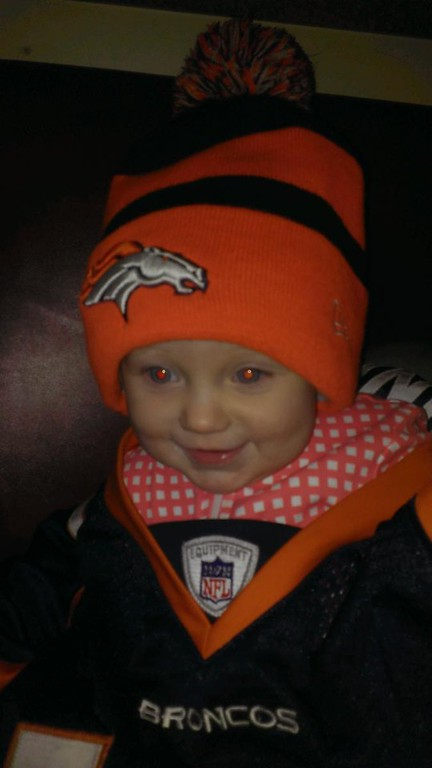 . Leah is one year old and a Manning Fan. She loves the horse. Good luck in the Super Bowl Broncos!
